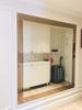 Gương ghép tường ô chéo phòng khách sang trọng